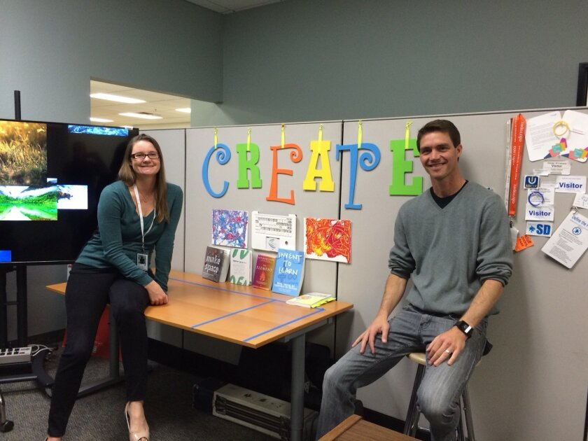 Escondido Union School District teachers Jo-Ann Fox and Colin Hanel are planning the new Quantum Academy specialty school, and their work area at the district headquarters is filled with signs, books and notes to inspire and generate ideas.