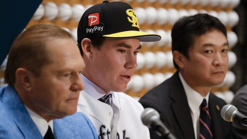 Sports agent, Scott Boras, left, SoftBank Hawks pitcher Carter Stewart Jr., center, and Hawks genera