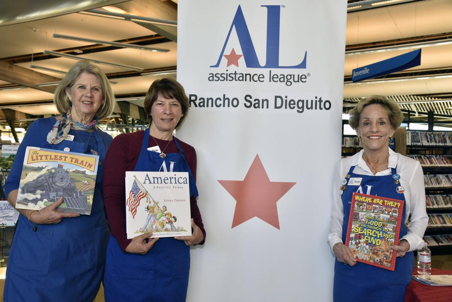 Linda Kermott, Pam Pacilio, and Suzie Perry of Assistance League of Rancho San Dieguito had a children's book give-away