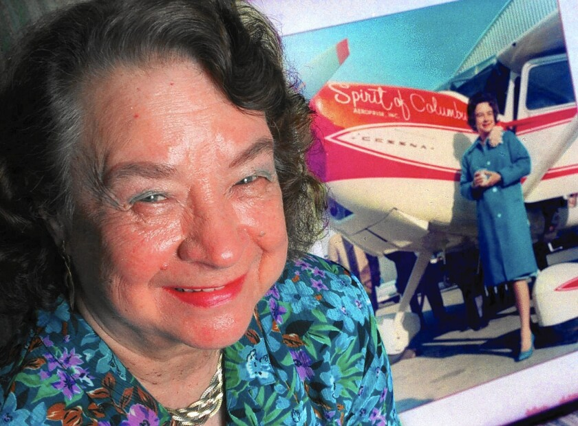 "Geraldine ""Jerrie"" Mock poses next to a photograph of her that was taken minutes before she began her flight around the world in 1964."