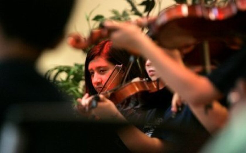 Students from the Oak Park Elementary School Music Conservatory play a concert last spring at the George L. Stevens Senior Center. Music programs in the San Diego Unified School District are being threatened by budget cuts.