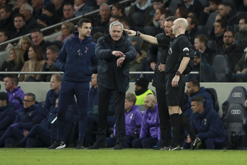 Tottenham's manager Jose Mourinho calls for referee's attention during the English Premier League soccer match between Tottenham Hotspur and Chelsea, at the Tottenham Hotspur Stadium in London, Sunday, Dec. 22, 2019. (AP Photo/Ian Walton)