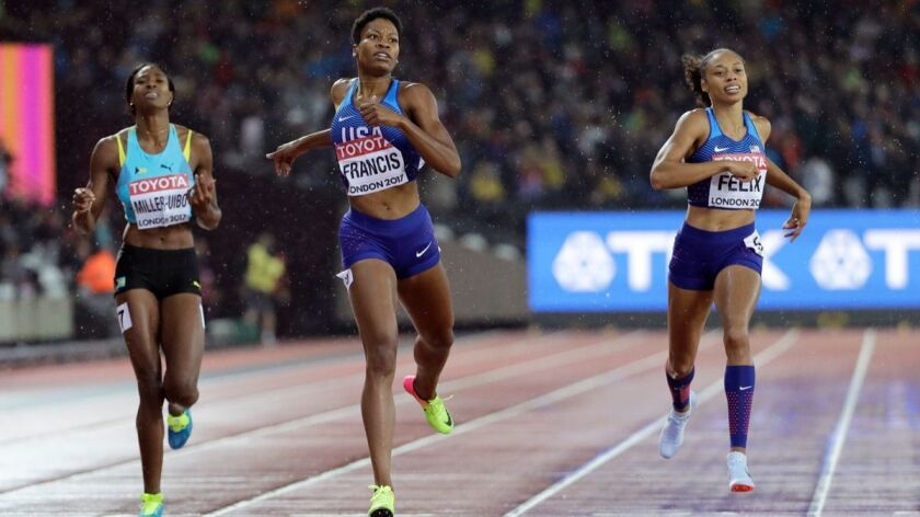 Phyllis Francis, center, crosses the line to win the gold medal in the Women's 400-meter final ahead