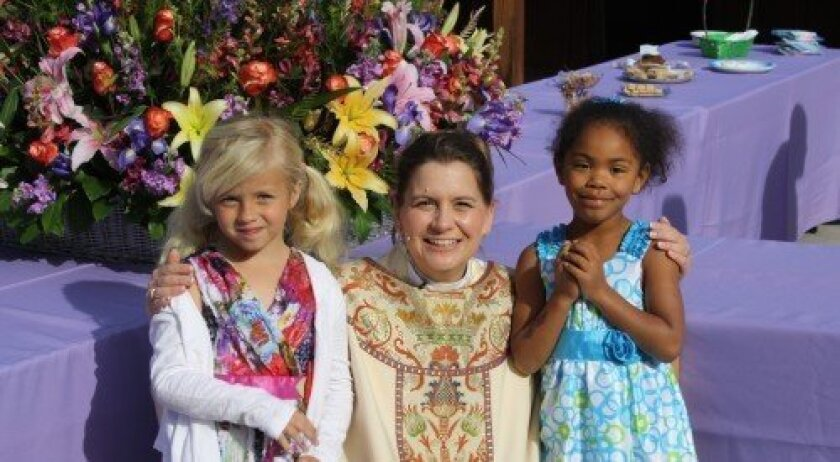 The Rev. Paige Blair with two young members of St. Peter's on Easter Sunday last year. Courtesy photo