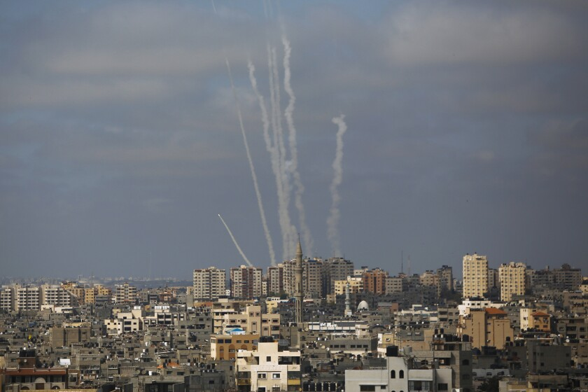 Trails from rocket launches above Israeli cityscape