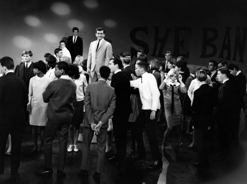 "Casey Kasem, center, hosting the KTLA teenage dance party ""Shebang!"" in Los Angeles, circa 1965."