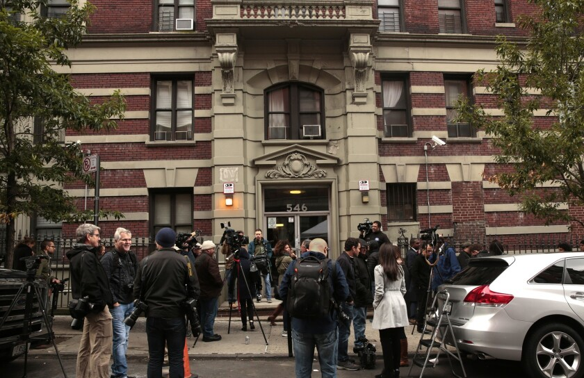 Members of the news media crowd outside Dr. Craig Spencer's apartment building after his diagnosis with Ebola was confirmed.