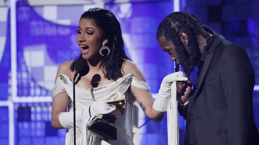 LOS ANGELES, CA - February 10, 2019 Cardi B, left, accepts an award for Best Rap Album with husband,