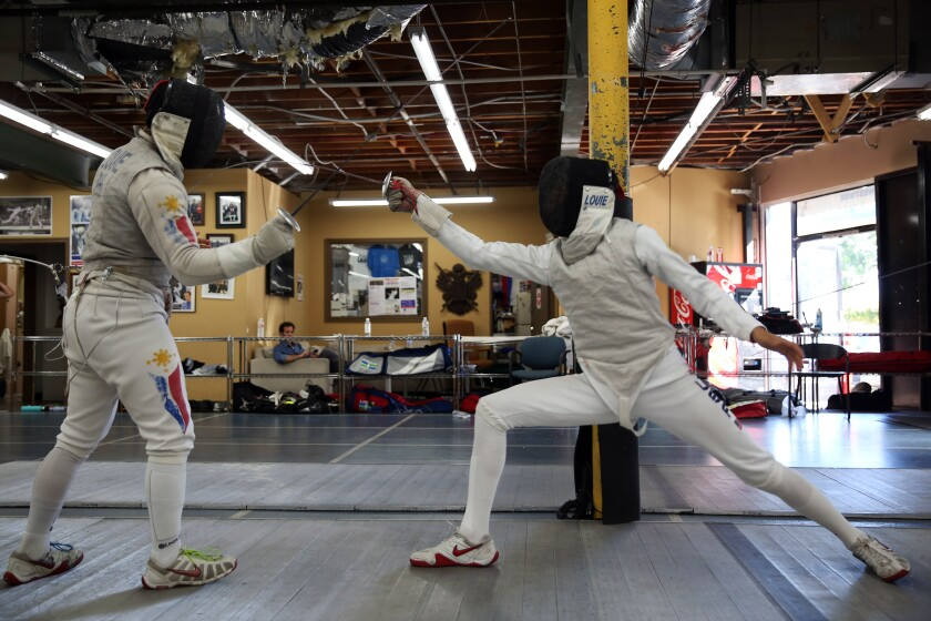 4Brothers Brennan, left, and Bryce Louie fence during a practice session at Los Angeles International Fencing Center in Los Angeles.