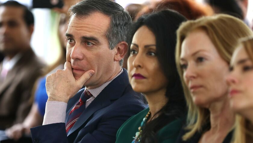Mayor Eric Garcetti and Councilwoman Nury Martinez, center, listen to a panel of women discuss their experiences with sexual harassment in the workplace.