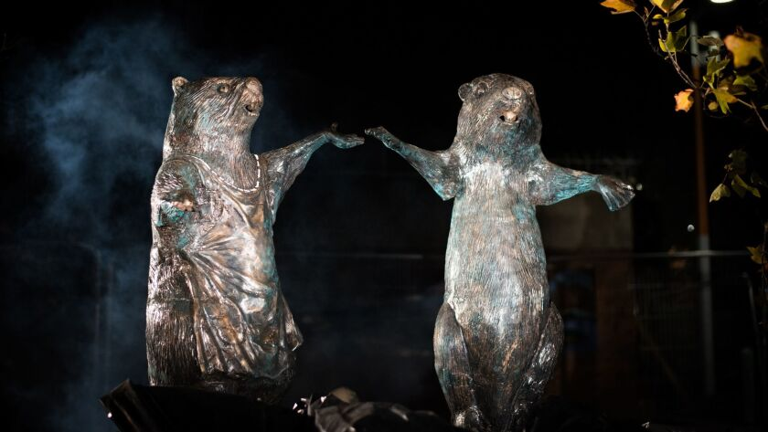 Mr. and Mrs. Beaver, among the statues in C.S. Lewis Square, sheltered the children when they first arrive in Narnia.