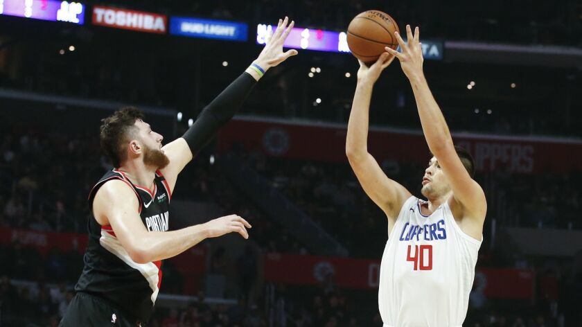 Los Angeles Clippers' Ivica Zubac (40) shoots over Portland Trail Blazers' Jusuf Nurkic (27) during