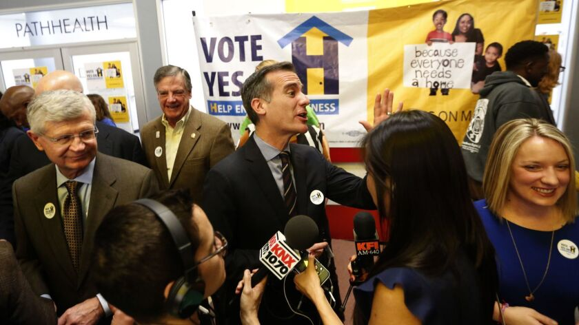 Los Angeles Mayor Eric Garcetti, center, at a Measure H kickoff event in 2017. The state Fair Political Practices Commission is examining whether L.A. County violated campaign law in promoting the tax measure last year.