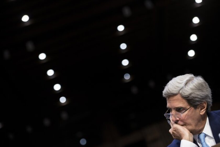 U.S. Secretary of State John Kerry listens during a hearing Tuesday of the Senate Foreign Relations Committee in Washington.