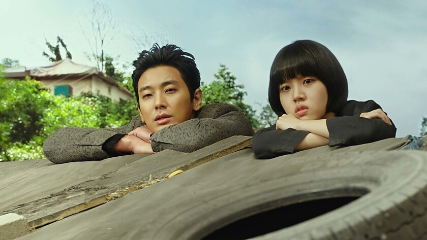 "Ju Ji-hoon and Kim Hyang-gi in the movie ""Along With the Gods: The Last 49 Days."""