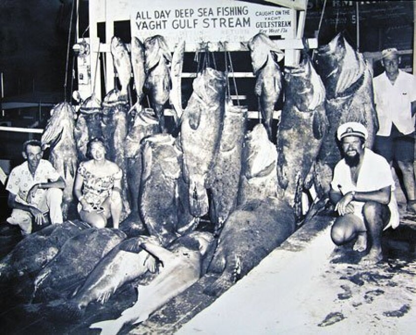 A Scripps researcher used decades of photos from the same Florida day-boat dock, including the one above from 1957, to estimate how fish sizes have declined. (Courtesy Loren McClenachan)