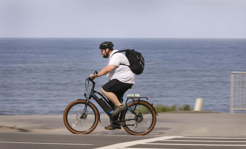 A bicyclist rides along Carlsbad Boulevard at Pine Avenue in Carlsbad during Bike to Work Day 2018.