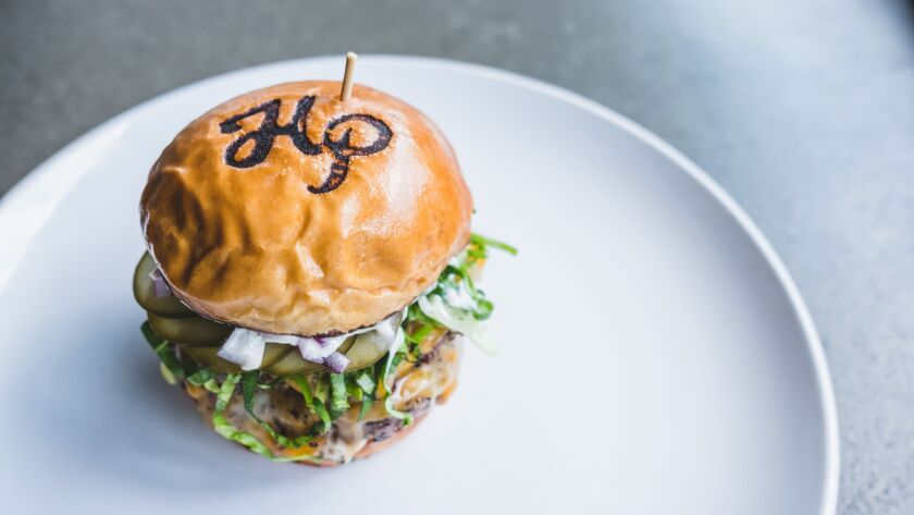 Hundred Proof's HP Burger, with branded bun.