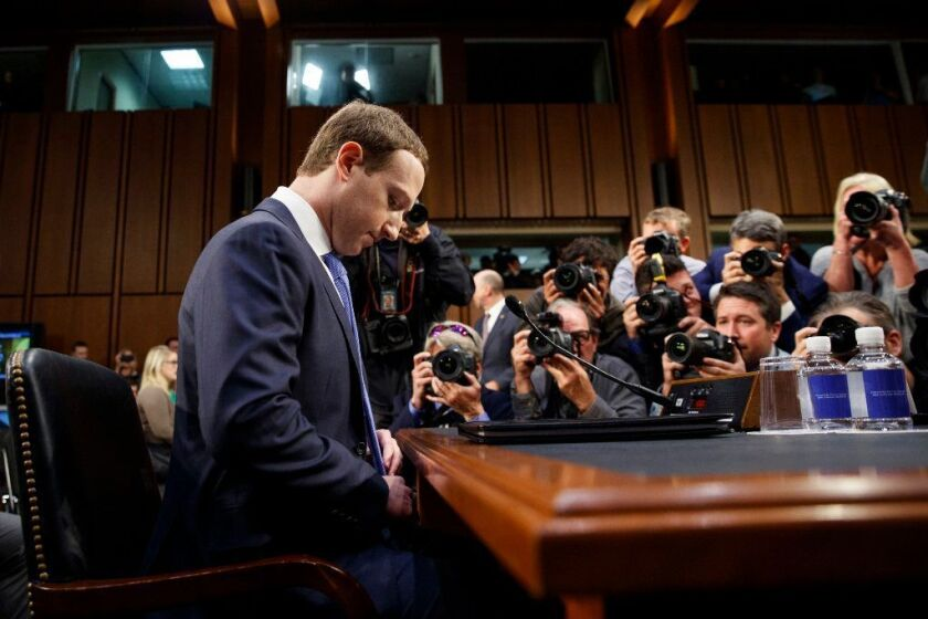 Facebook Chief Executive Mark Zuckerberg arrives to testify before a joint hearing of the Commerce and Judiciary Committees on Capitol Hill in Washington on April 10, 2018.