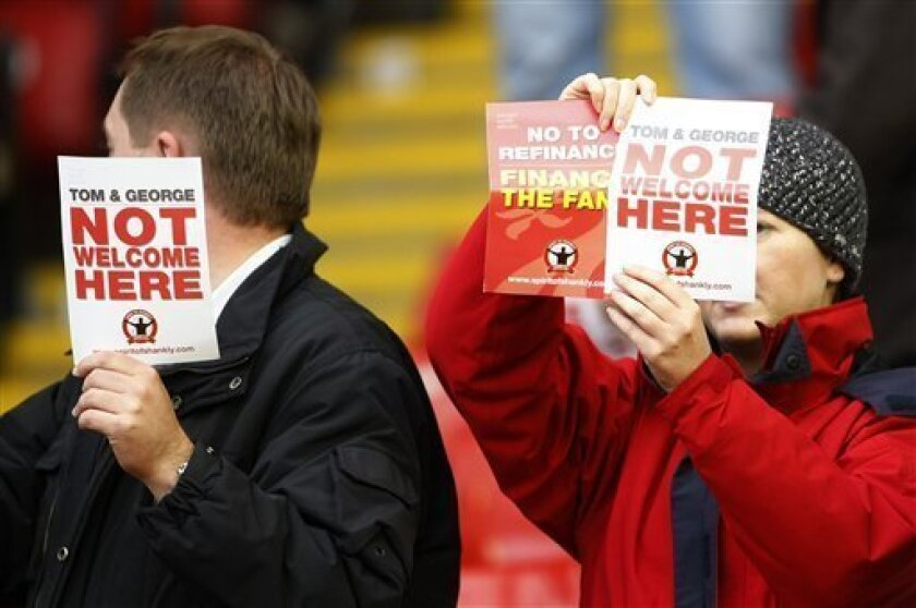Liverpool fans protest against their American owners after losing to Blackpool in their English Premier League soccer match at Anfield, Liverpool, England, Sunday Oct. 3, 2010. (AP Photo/Tim Hales)
