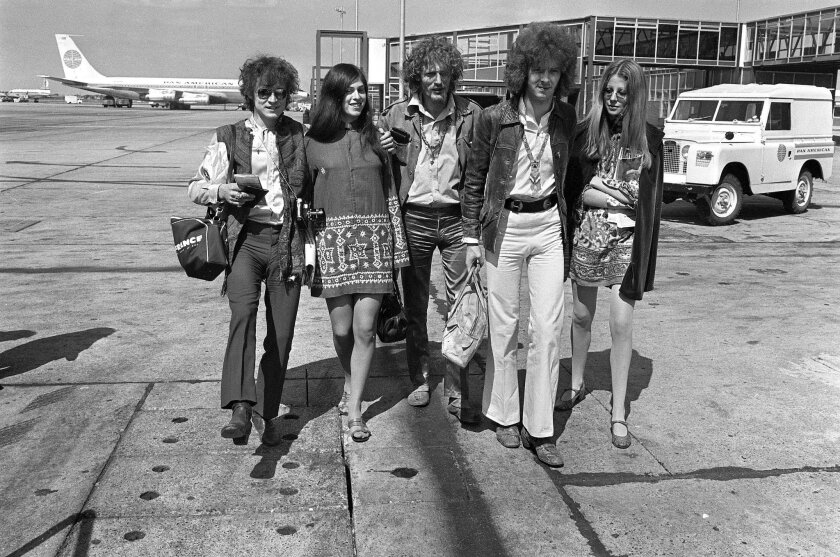 FILE - In this Aug. 20, 1967 file photo, members of the rock group Cream, from left, Jack Bruce, unidentified woman, drummer Ginger Baker, and Eric Clapton. depart from Heathrow Airport in London. Bruce, best known as the bassist from Cream, has died. He was 71. A statement released by his family announced the death Saturday, Oct. 25, 2014. Publicist Claire Singers said Bruce died at his home in Suffolk, England. (AP Photo/Peter Kemp)