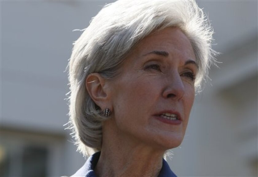 Health and Human Services Secretary Kathleen Sebelius speaks to reporters outside the White House in Washington, Thursday, March 4, 2010, after meeting with various state insurance commissioners and insurance industry executives at the White House. (AP Photo/Charles Dharapak)