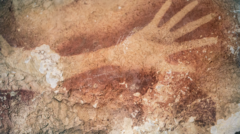 Researchers have determined a hand stencil in an Indonesian cave to be nearly 40,000 years old.