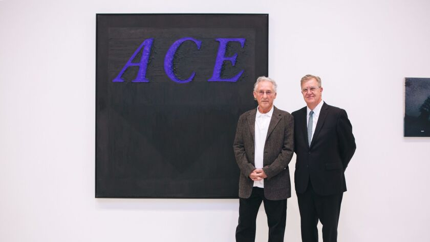"California artist Ed Ruscha, left, and Hugh Davies. ""Ace,"" a 1968 painting by Ruscha, was puchased by MCASD in the 1980s."