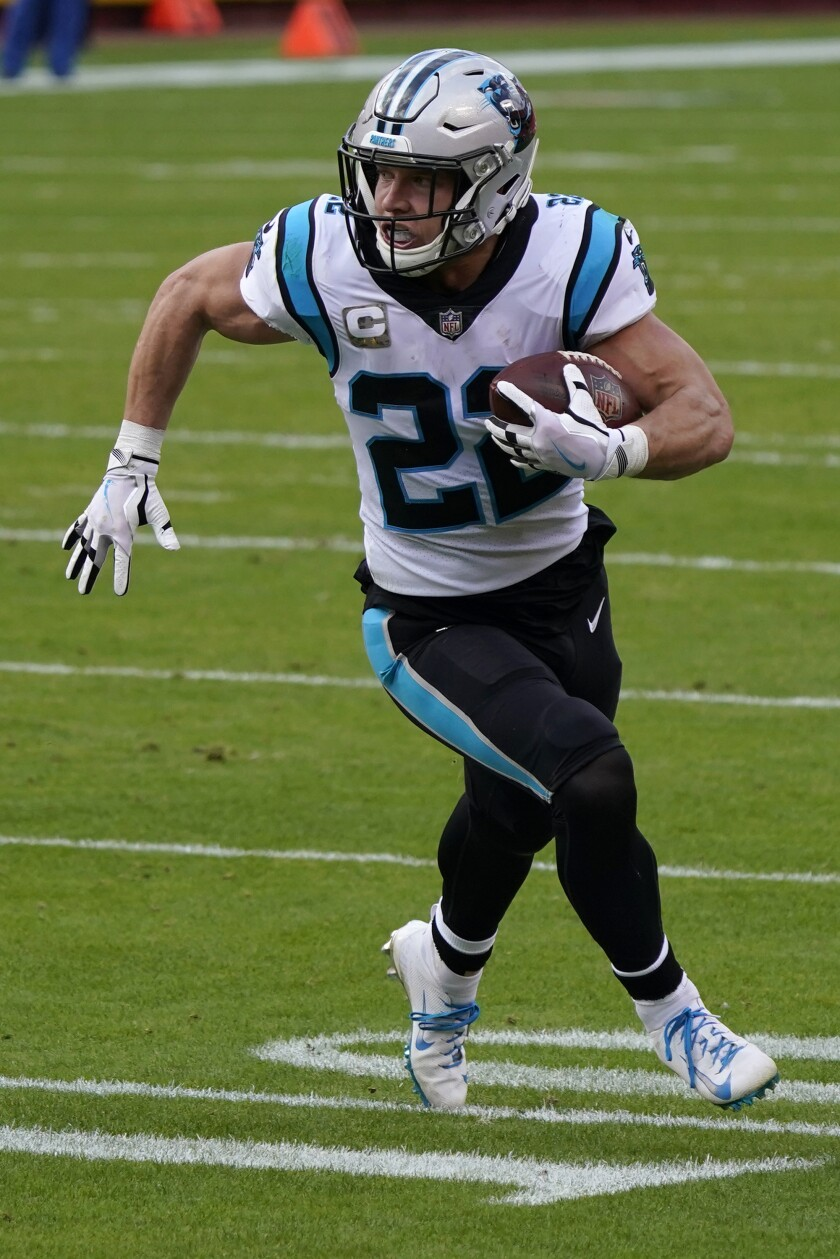 Carolina Panthers running back Christian McCaffrey (22) runs toward the end zone to score against the Kansas City Chiefs during the first half of an NFL football game in Kansas City, Mo., Sunday, Nov. 8, 2020. (AP Photo/Jeff Roberson)