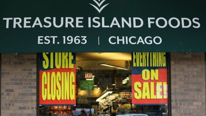 Store closing signs are displayed Sept. 29, 2018, at a Treasure Island grocery store at 75 W. Elm St. in Chicago. A produce wholesaler is suing Treasure Island Foods, accusing the company of not paying for more than $453,000 worth of fruits and vegetables.