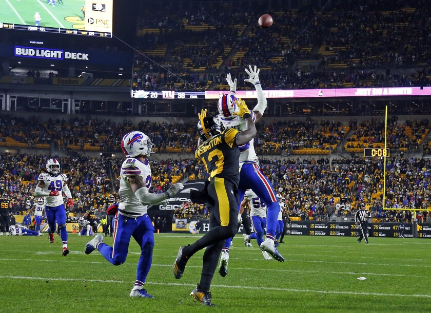 Buffalo Bills cornerback Levi Wallace intercepts a pass intended for Pittsburgh Steelers wide receiver James Washington.