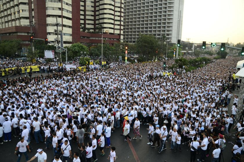 In this Saturday, Feb. 15 photo released by the Iglesia Ni Cristo, thousands walk along a road beside Manila's Bay, Philippines as they join the largest charity walk to raise funds for survivors of last year's Typhoon Haiyan. A Guinness World Records official says the Philippine Christian sect has broken two records for staging the largest charity walk. Guinness adjudicator Kirsty Bennett says 175,509 Iglesia ni Cristo members turned up for the charity walk in Manila on Saturday. She also said Iglesia Ni Cristo members staged the walk in 28 other countries, with participants reaching 519,221 worldwide, breaking another record for the largest charity walk in multiple venues. (AP Photo/ Iglesia Ni Cristo, HO)