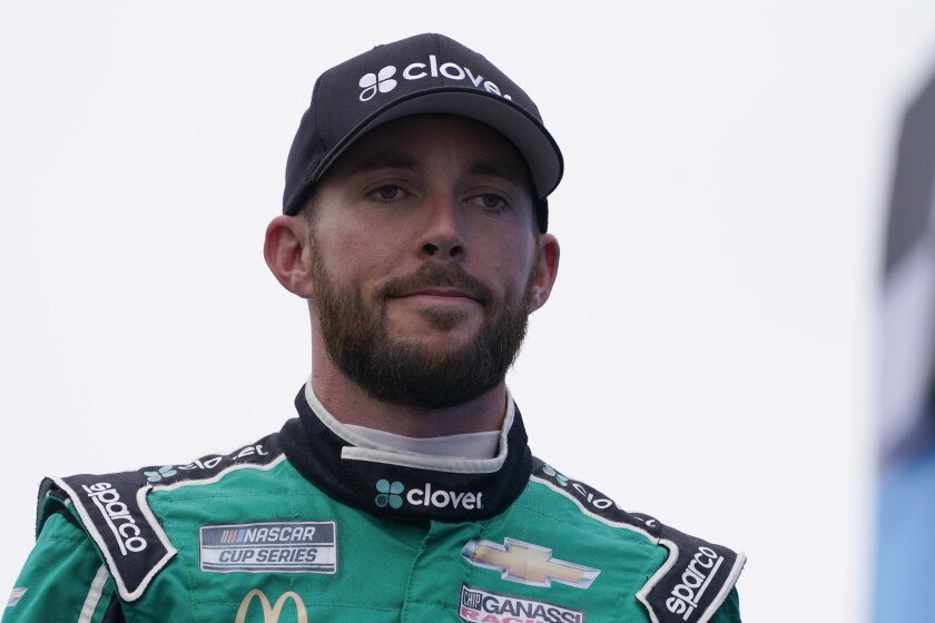 FILE - In this July 18, 2021, file photo, Ross Chastain looks on at a NASCAR Cup Series auto race in Loudon, N.H. Trackhouse Racing has signed Chastain to a multiyear contract to drive the No. 1. The 28-year-old Chastain currently drives the No. 42 Chevrolet for Chip Ganassi Racing. (AP Photo/Charles Krupa, File)