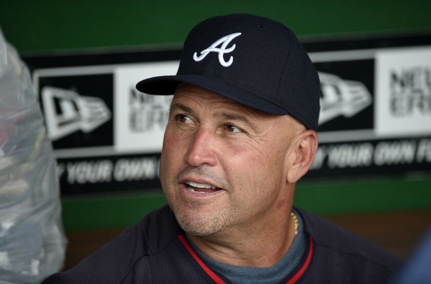 FILE - In this Sept. 10, 2014, file photo, Atlanta Braves manager Fredi Gonzalez talks to the media before a baseball game against the Washington Nationals in Washington. Gonzalez will return as the Braves manager next season. Interim general manager John Hart made the announcement Friday, Oct. 3, 2014. (AP Photo/Nick Wass, File