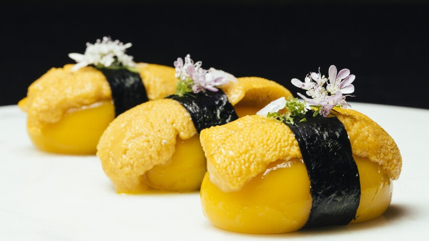 Liquid mango nigiri and sea urchin made with spherical mango, sea urchin, nori, cilantro flower, and lime zest at SAAM at the Bazaar by Jose Andres in Los Angeles.