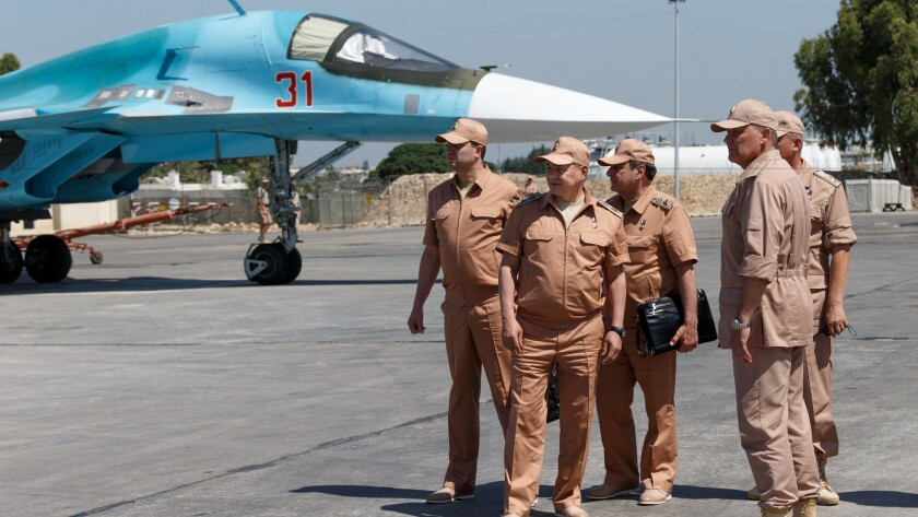 Russian Defense Minister Sergei Shoigu, second from left, visits the Hemeimeem air base in Syria on June 18.