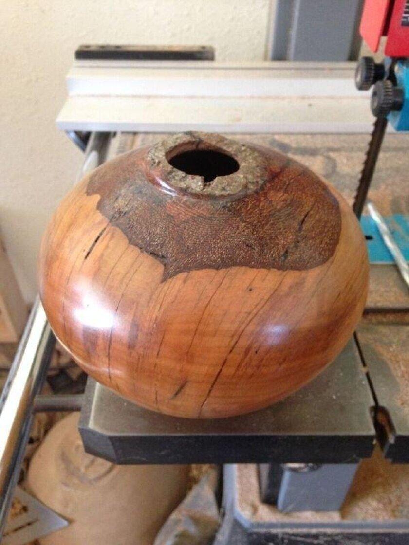 A wooden bowl sculpted by Aquino.