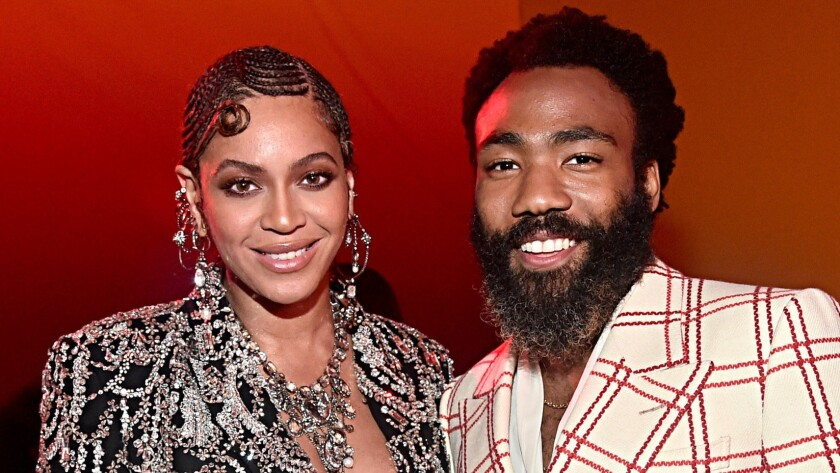 "Beyoncé Knowles-Carter, left, and Donald Glover pose at the ""Lion King"" world premiere on Tuesday."