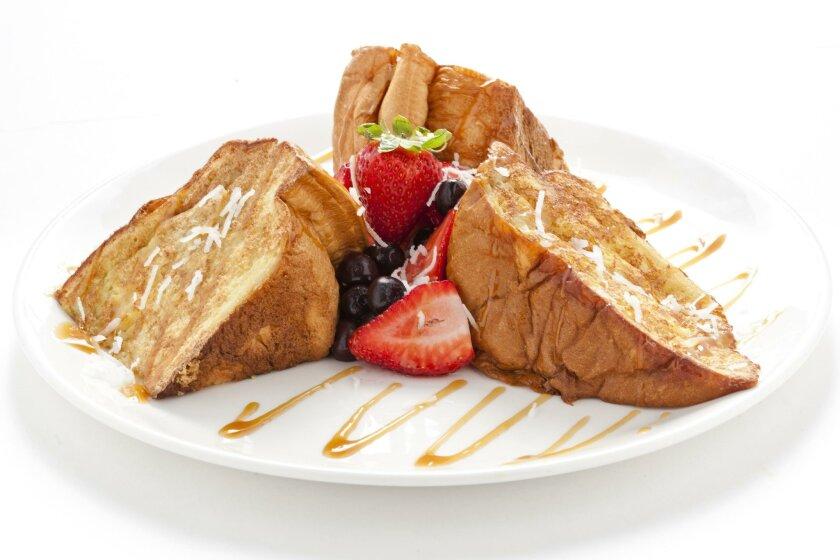 The Tiki Toast at Broken Yoke Cafe is a customer favorite.