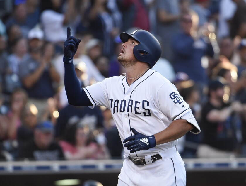 Padres home run leader Hunter Renfroe points skyward as he crosses home plate after hitting his 31st homer of the season Aug. 10 against the Rockies at Petco Park.