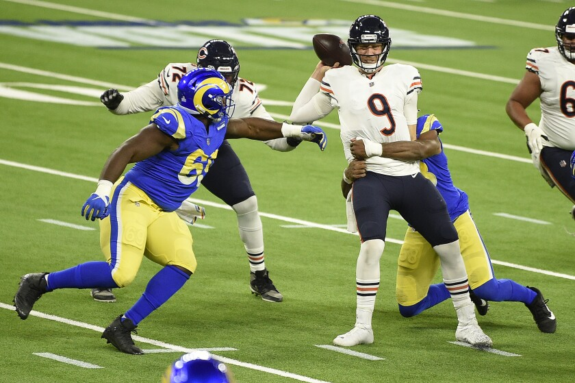 Chicago Bears quarterback Nick Foles (9) is sacked by Los Angeles Rams linebacker Justin Hollins during the second half of an NFL football game Monday, Oct. 26, 2020, in Inglewood, Calif. (AP Photo/Kelvin Kuo)