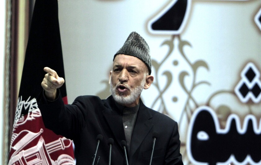 Afghan President Hamid Karzai speaks during a national consultative council, known as a loya jirga, in Kabul.
