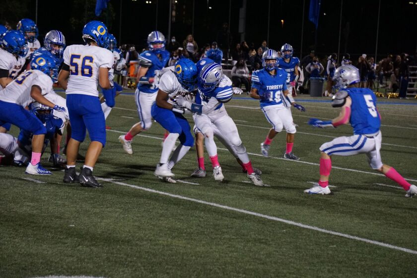 La Jolla Country Day School (in blue) battles O'Farrell Charter School on Oct. 8 in an eventual 63-6 Country Day victory.