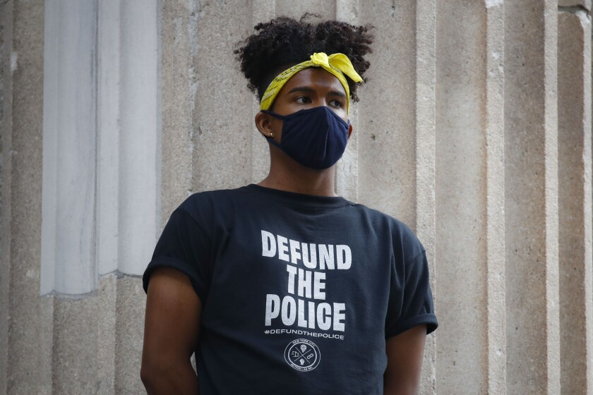 """Protester outside New York City Hall in a """"Defund the Police"""" shirt."""