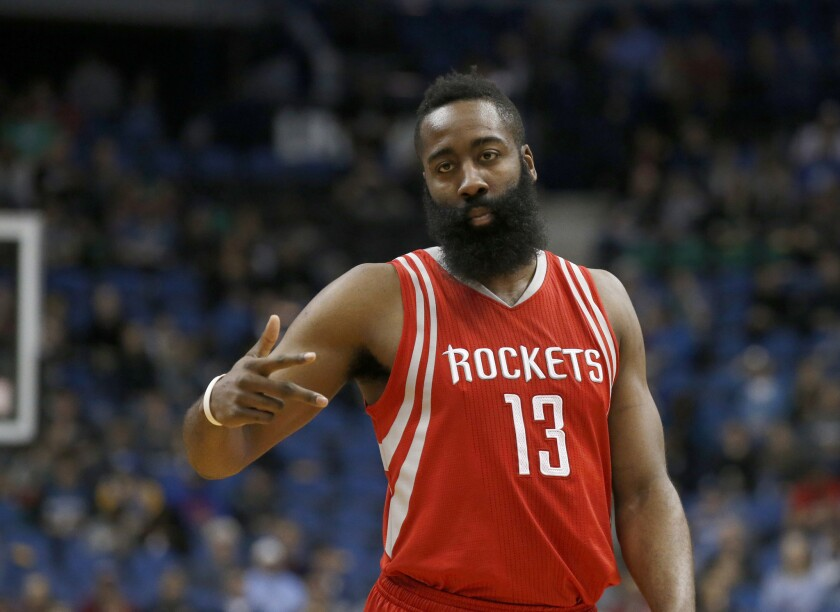 Rockets guard James Harden reacts after making a basket during a game last season.