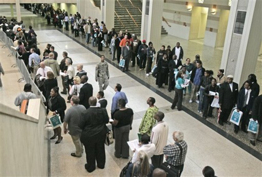 A line winds through the Cleveland Convention Center as people wait in line to enter a job fair, Thursday, May 14, 2009, in Cleveland. Americans should brace themselves for a slow recovery back to health after the recession ends, with unemployment likely to hit the double-digits, a Federal Reserve official said Friday. (AP Photo/Tony Dejak)