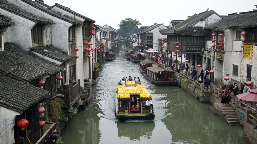 """Considered the """"Venice of China,"""" Suzhou sits in the center of the Yangtze River Delta, where gondolas push through narrow waterways, lit by paper lanterns and shadowed by stone bridges."""