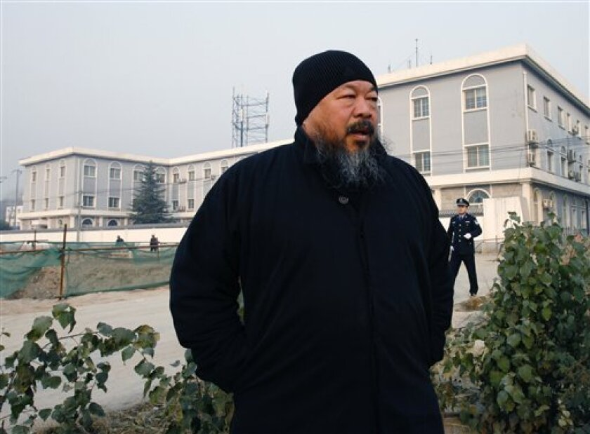 Artist Ai Weiwei arrives to the Wenyuhe court to support fellow artist Wu Yuren during his trial in Beijing, China Wednesday, Nov. 17, 2010. Wu was detained and charged after he helped organize protests near Tiananmen Square against some urban development schemes in the 798 artist area of Beijing e