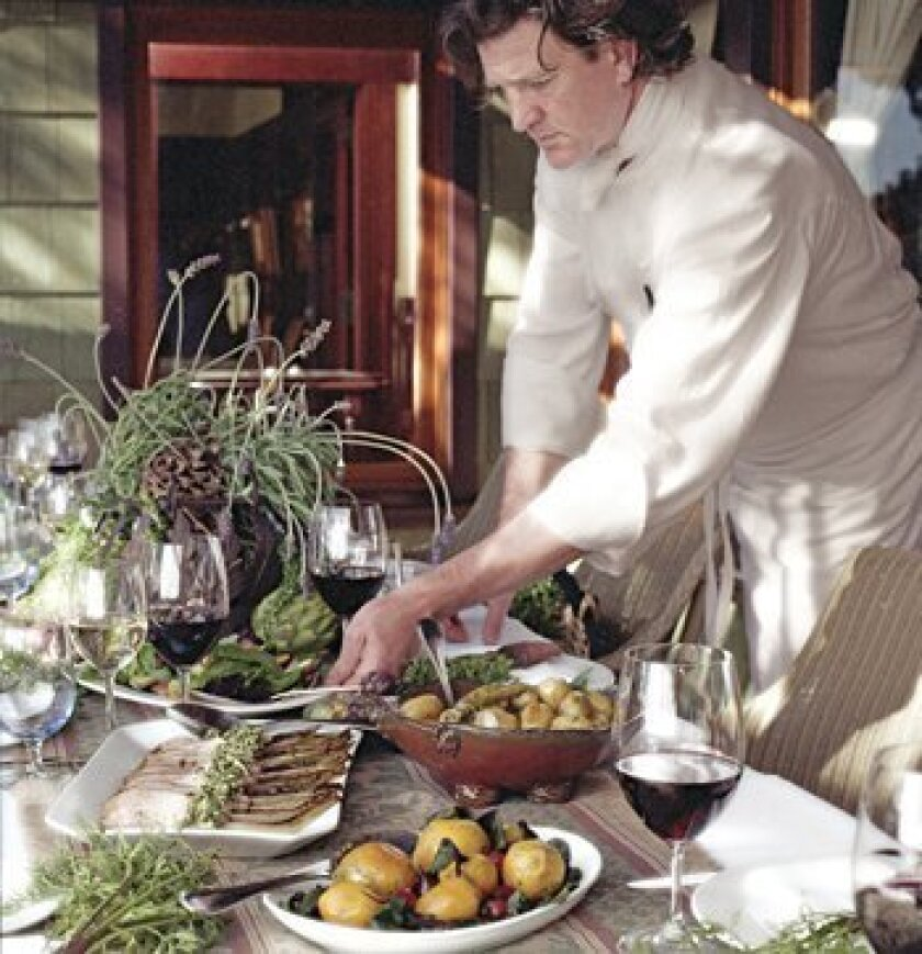 Executive Chef Jeff Jackson sets up the artisan table at the 2009 Celebrate the Craft event at The Lodge at Torrey Pines. Photo: Courtesy