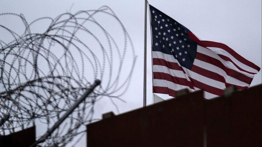 A U.S. flag near the border fence in San Diego County.